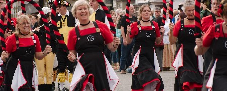 Morris dancers working together